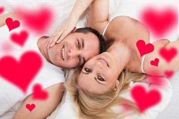 Loving Young Couple Lying In Bed