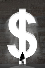 Businessman Standing In Front Of Large Dollar Sign