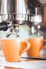 Orange cup of coffee for espresso