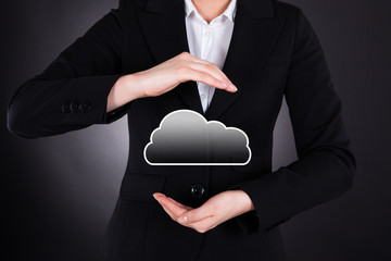 Businesswoman Holding Cloud Computing Icon