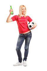Female sports fan holding beer and a football