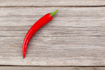 Red chili pepper on the wooden background