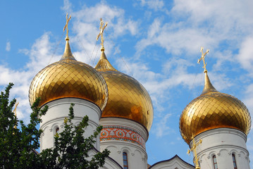 Golden cupolas of Assumption Church in Yaroslavl, Russia.