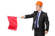 Construction worker holding a red flag