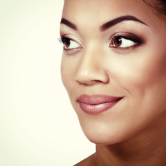 Young mulatto fresh woman with beautiful makeup