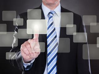 Businessman Pushing Button On Transparent Screen