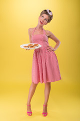 Beautiful emotional girl with pretty smile in pinup style posing