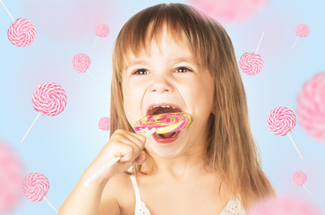 happy little girl eating a lollipop candy