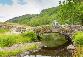 Packhorse bridge over river Watendlath Lake District