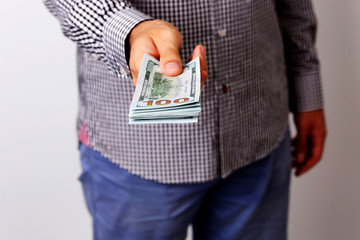 Closeup portrait of a male hand holding US dollars