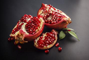 Piece of pomegranate on black background