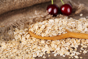 Oatmeal scattered on wooden background