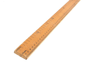 Close up photo of a wooden meteric ruler on a white dackground
