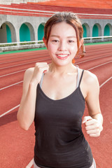 Chinese woman jogging on track