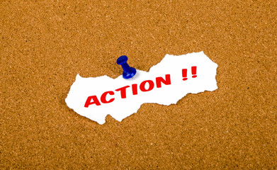 action concept on cork noticeboard