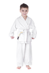 A young boy fighter in white kimono isolated on white background