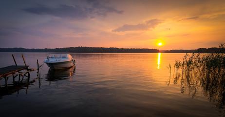 Idyllic panorama landscape of Swedish lake sunset