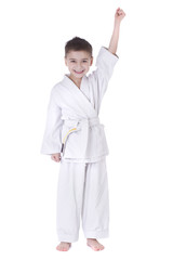Young boy fighter in kimono with hand up isolated on white backg