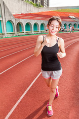 Chinese woman jogging in race