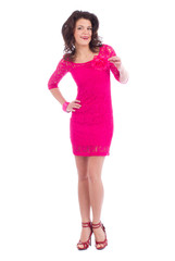 Attractive carefree young lady dressing pink dress posing on whi