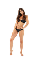 Beautiful young woman in black swimsuit isolated on white