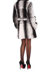Woman wearing gray fur coat
