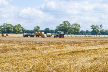 Tractor collecting bales