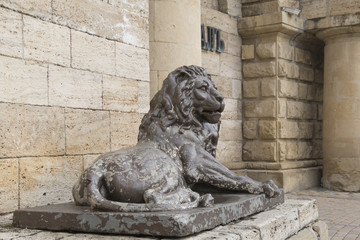 Lion sculpture before  tunnel to the underground lake Proval, Py
