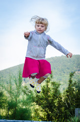 blond girl jumping