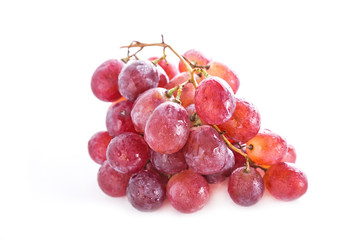 Fresh red grapes isolated on white background