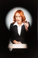 keyhole view of young pretty business woman.