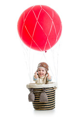 happy child on hot air balloon with thumb up