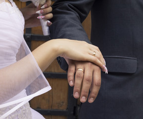 Newlyweds hands with gold rings