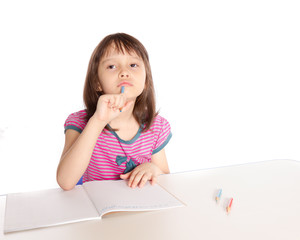 Girl doing homework, deep in thought