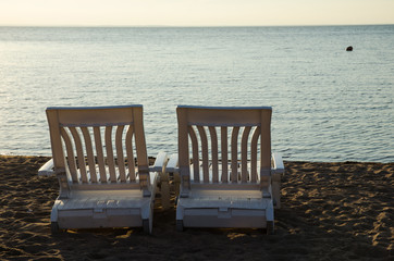 Two armchairs at beach