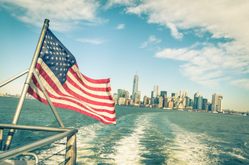 New York and Manhattan skyline with american flag