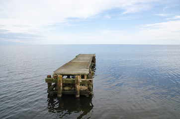 Deserted jetty surrounded by the water