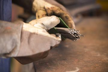 Repairman repairing a car part in repair shop