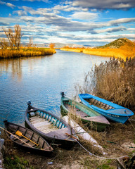Wetland area in south Croatian with traditional boats in front