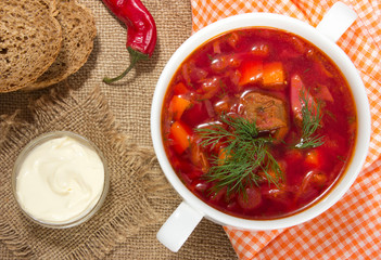 Borsch in white bowl . Red beetroot traditional soup.