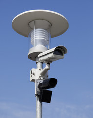 Security camera mounted on street lamp.