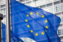 "Постер, картина, фотообои ""EU flag in front of Berlaymont building facade"""