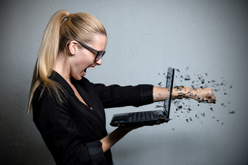 young business woman destroying her notebook