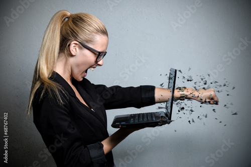 canvas print picture young business woman destroying her notebook