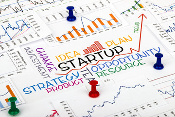 startup concept with financial and marketing chart