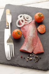 pink herring with tomato and onion