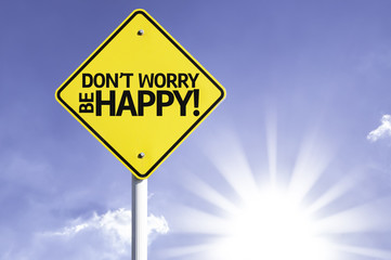 Don't Worry, Be Happy! road sign with sun background