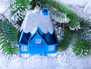 Dark blue New Year's toy small house- idea of dream of own house