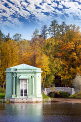 Ancient pavilion on lake in palace park.Gatchina.Petersburg.