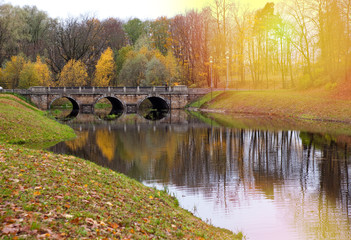 The bridge over a river in autumn park